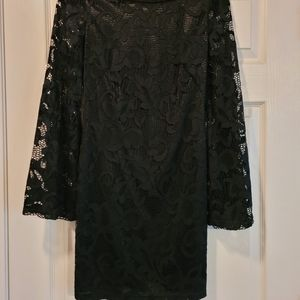 Gorgeous bebe Black lace dress with bell sleeves.